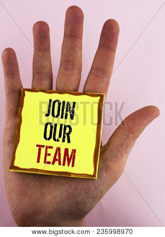 Text sign showing Join Our Team. Conceptual photo Get over unemployment joining better career workforce written Yellow Sticky Note Paper placed the Hand the plain background. poster