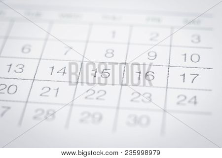 Closeup On Dates Of Simple Calendar Page. Selective Focus Shown Dot Prints, Blurred Area On Top And
