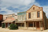 Wooden buildings in an old American western town poster