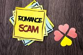 Text sign showing Romance Scam. Conceptual photo Dating Cheat Love Embarrassed Fraud Cyber Couple Affair written Stacked Sticky Note Papers the wooden background Hearts next to it. poster
