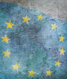 Stylized Image Of Flag Of European Union Against The Old Wall Background