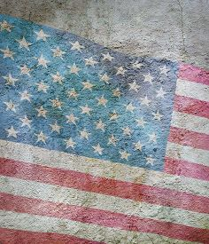 Stylized Image Of Flag Of America Against The Old Wall Background