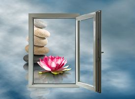Open Window On Lotus Flower And Stones Background Closeup