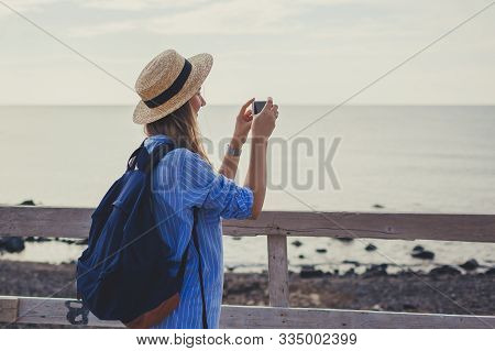 Woman Traveler Walking On Vlychada Beach In Akrotiri On Santorini Island, Greece. Tourist Admiring A