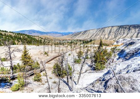 Overlook Of The Lower Terraces Of Mammoth Hot Springs At Yellowstone National Park With Mount Everts