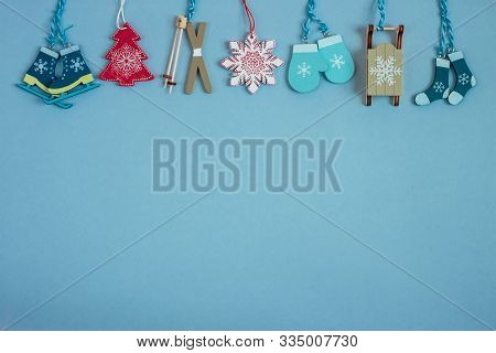Christmass Decoration On Blue Paper Craft Background. Copy Space