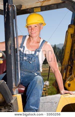 Senior Woman On Backhoe