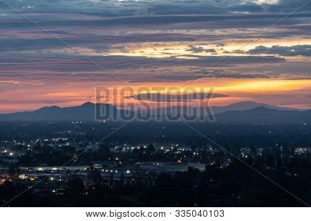 Los Angeles San Fernando Valley dawn with colorful fall clouds.  View towards Griffith Park and the Santa Monica Mountains from the Santa Susana Pass in Chatworth, California.