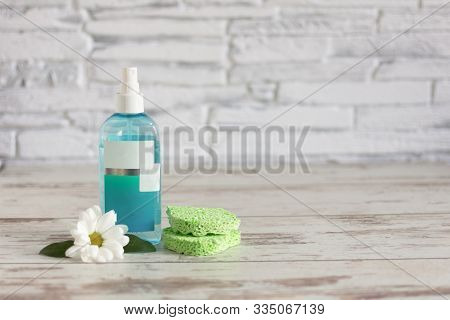 Natural Herbal Skin Care Tonic With Chamomile Flower. Facial Refreshment Tonic On Wooden Background.