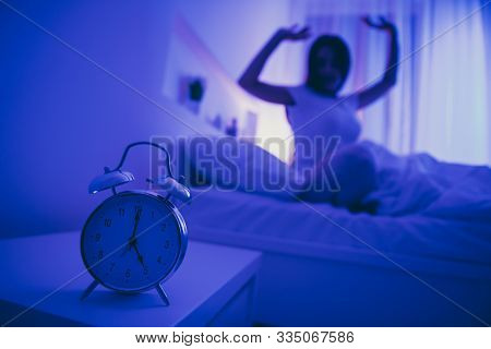Close-up View Of Alarm Call Bell Clock Nice Attractive Peaceful Healthy Girl Sitting In Bed Stretchi