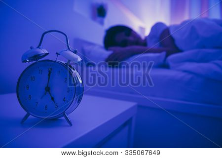 Close-up View Of Alarm Call Bell Clock Nice Attractive Peaceful Serene Girl Lying In Bed Covered By
