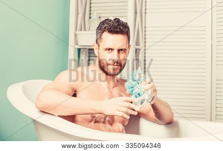 Macho With Sponge Take Bath At Home. Taking Bath With Soap Suds. Pampering And Beauty Routine. Hands