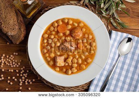 Chickpea Stew Dish (potage - Cocido Madrileño). With Beef, Sausage (chorizo), Bacon, Carrots And Oli
