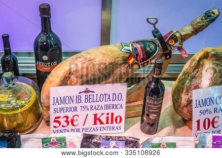 Madrid, Spain - January 22, 2019: Jamon Ham On A Shop Window Of Museo Del Jamon Bar In Madrid City
