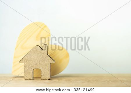 House Model On Table. Buying A Home With A Small Family, Affordable Housing. Mortgage Property Insur