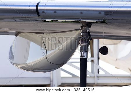 Refueling Aircraft Process At The Airport, Close-up