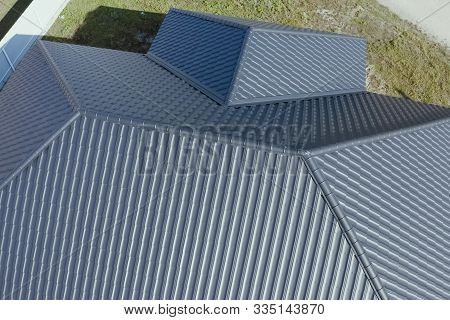 House With A Gray Metal Roof. Modern Roof Made Of Metal. Corrugated Metal Roof And Metal Roofing.