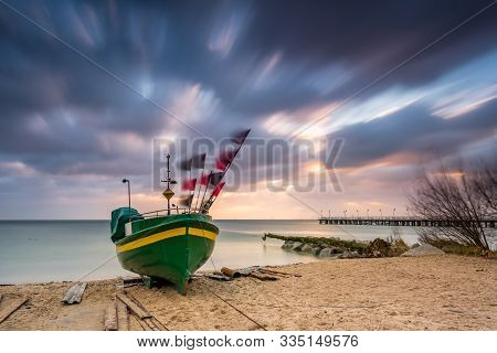 Fishing Boat On The Beach During Sunrise In Gdynia. Baltic Sea. Poland