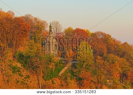 Scenic Autumn Landscape Of Hill, Trees With Yellow And Red Leaves. View Of Volodymyr Hill And The Mo