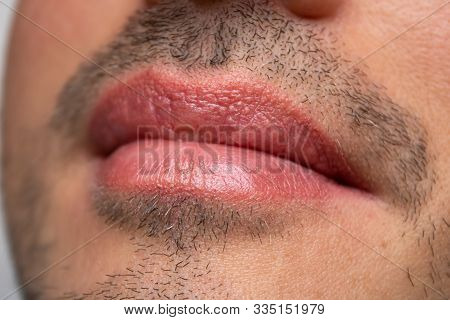 Male NU Lips. Young man closeup lips, male permanent make up, mens bristle. poster