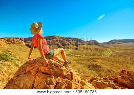 Woman Resting After Trekking At Ormiston Pound Walk In West Macdonnell Ranges. Mount Sonder Lookout,