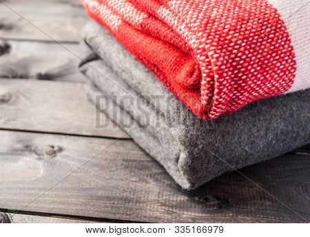 A Stack Of A Warm Woolen Colored Blankets