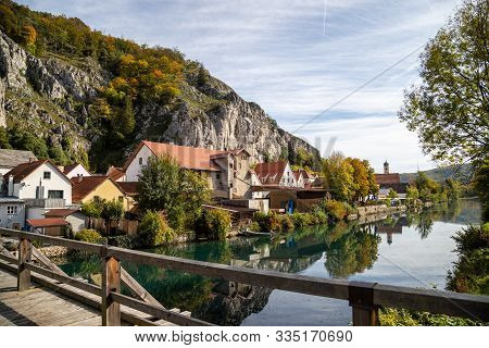 Idyllic View At The Village Markt Essing In Bavaria, Germany With The Altmuehl River, High Rocks In