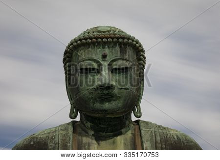 Kamakura, Japan - November 1st, 2018: A Close Up Photograph Of The Giant Buddha Statue At The Kotoku