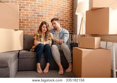 Confused Couple Of Having To Move And Arrange All The Packages. Concept Of Success, Delusion, Change
