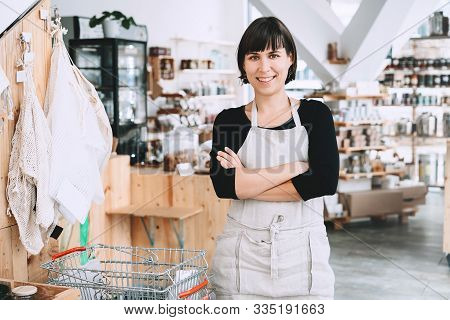 Portrait Of Owner Of Sustainable Small Local Business. Female Seller Assistant Of Zero Waste Shop On