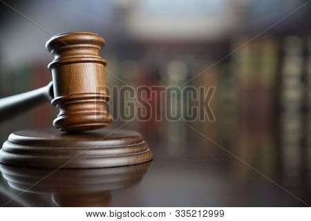 Judge Concept. Gavel Of  The Judge In The Old Court Library.
