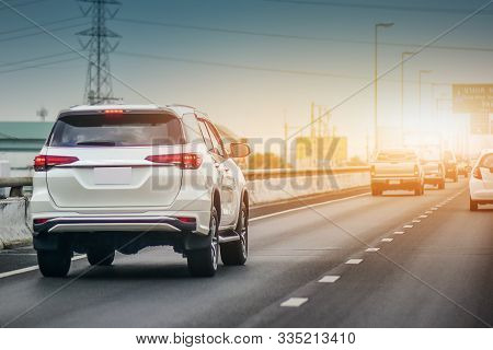 Car Driving On Road And Small Passenger Car Seat On The Road Used For Daily Trips