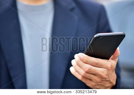 Businessman Holding Cell Phone Using Mobile Phone Or Smart Phone Telephone To Call Phone With Social