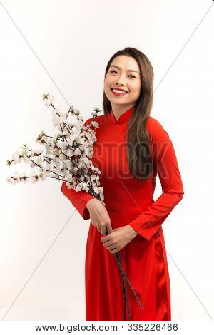 Asian Girl In Ao Dai, Concept Celebrating Lunar New Year Or Spring Festival, Isolated On White Backg