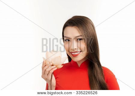 Beautiful Asian Girl In Ao Dai Holding Lotus Flower On Her Hand