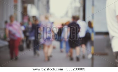 Anonymous Crowd Of People Walking City Street In Soft Focus. Footage Of Blurred Unrecognizable Peopl