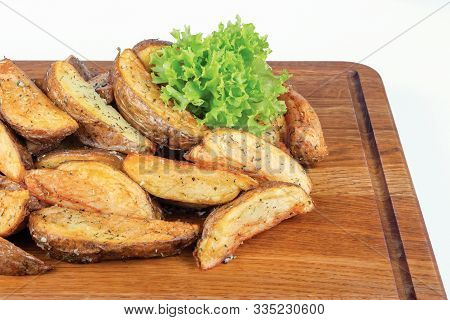 Fried Potato Wedges. Home Made In Rural Style And Served On On Wooden Board. Healthy Organic Vegetar
