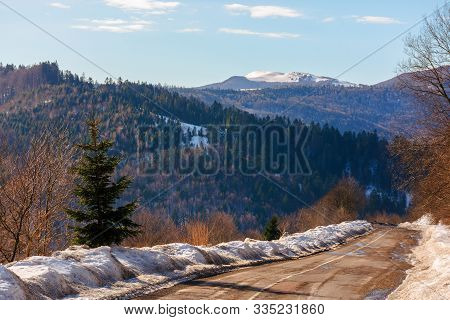 Winding Serpentine In Winter. Lovely Transportation Scenery In Mountains
