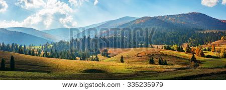 Rural Area Of Carpathian Mountains In Autumn. Wonderful Panorama Of Borzhava Mountains In Dappled Li