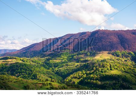 Beautiful Mountainous Scenery In Springtime. Wonderful Afternoon Sunny Weather With Clouds On The Bl
