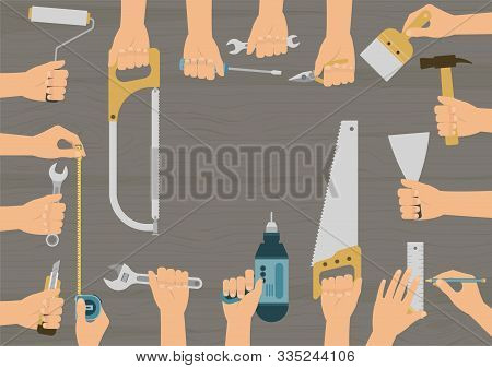 Realistic Hands Holding Several Construction, Repair And Diy Hand Tools Set On Wood Table Background