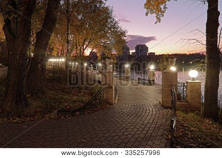 Khimki, Russia - October16, 2019:  View City Pedestrian Embankment On Moscow Canal Lit By Lanterns I