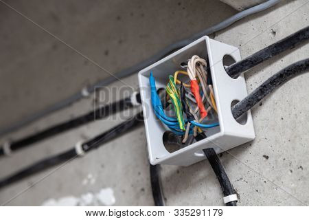 Cable Laying Ceiling. Electrical Wires On Wall. Wiring Replacement. Connecting Light In Flat Or Offi