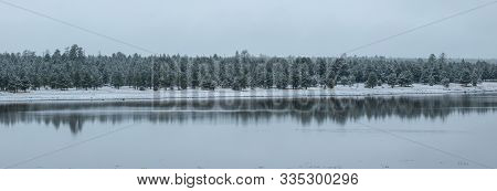 Snowy Winter Day On The Lake With Reflection