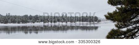 Snowy Winter Day At The Lake With Reflection