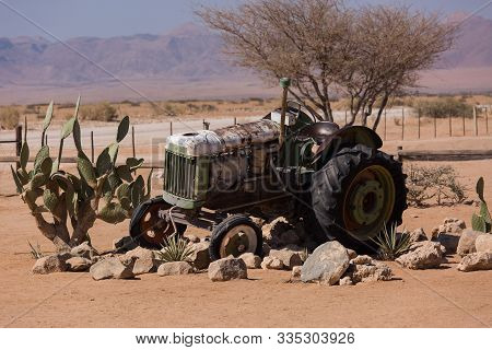 Abandoned Old Rusty Wrecked Historic Car Near A Service Station At Solitaire In Namibia Desert Ear T
