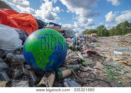 Beautiful Blue Green Planet Earth In Trash. Save Earth Planet World Concept. Environmental Conservat
