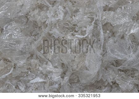 Background Of Clean Shredded Plastic Film. Raw Materials For The Production Of Secondary Granules Ld