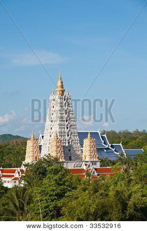 White Bodh Gaya style pagoda in blue sky poster