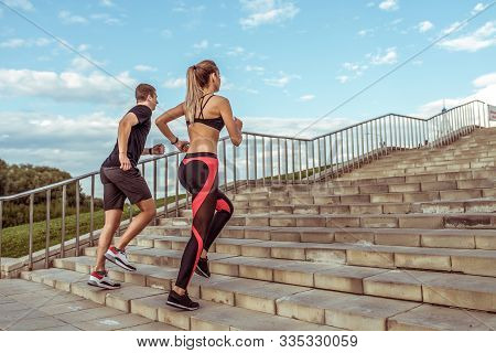 In Motion, Sports Young Fitness Couple, Man Woman, Jogging On Stairs, Doing Summer Fitness Training